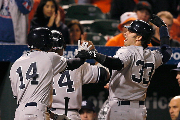 Curtis Granderson #14 and Nick Swisher #33 of the New York Yankees