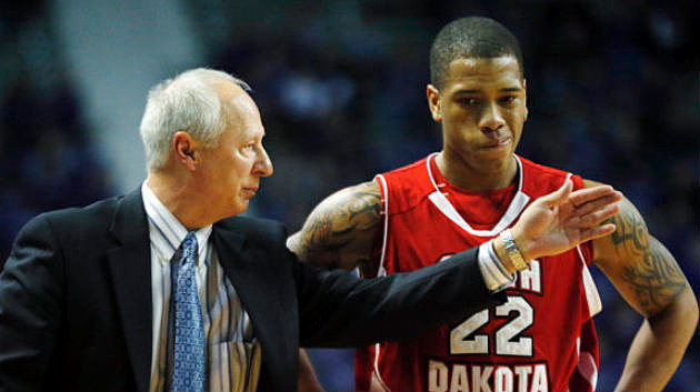 Head coach Dave Boots and Karim Rowson, University of South Dakota Coyotes