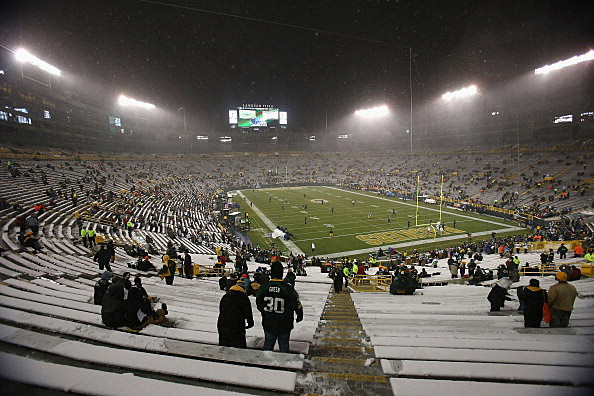 Snow falls over Lambeau Field