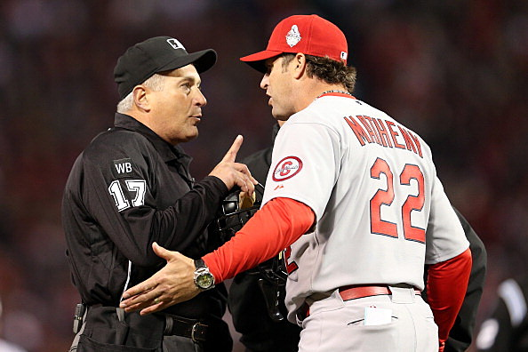 Home plate umpire John Hirschbeck and Mike Matheny, St. Louis Cardinals vs Boston Red Sox, 2013 World Series, Game 1