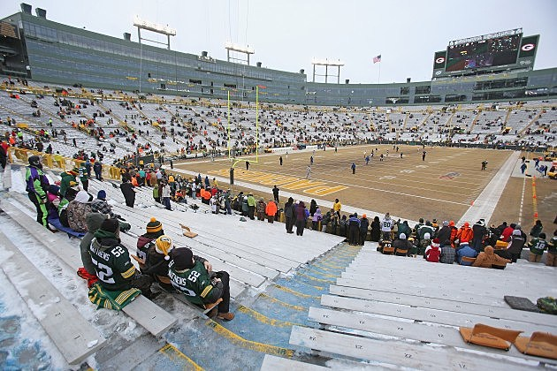 Fans of the Green Bay Packers watch a game at Lambeau Field