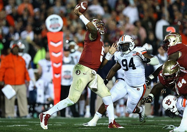Quarterback Jameis Winston #5 of the Florida State Seminoles passes the ball in the fourth quarter