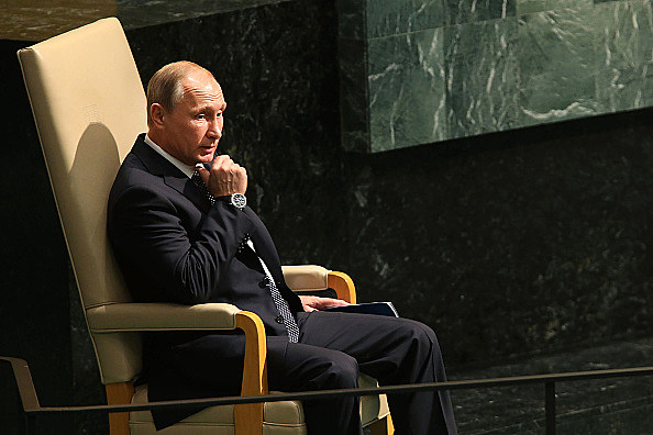 NEW YORK, NY - SEPTEMBER 28:  Vladimir Putin, President of Russia,  sits before addressing the United Nations General Assembly on September 28, 2015 in New York City. The ongoing war in Syria and the refugee crisis it has spawned are playing a backdrop to this years 70th annual General Assembly meeting of global leaders.  (Photo by Spencer Platt/Getty Images)